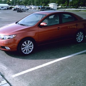 Forte SX sedan...beautiful color, nice wheels, and FUN to drive.