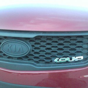 Moved the Koup emblem to the front of the car, blackout KIA emblem.